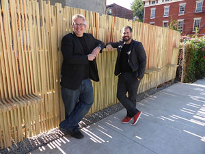 Architects David Quadrini and Brian Szymanik of MAKE Architecture + Planning in front of the interactive fence.