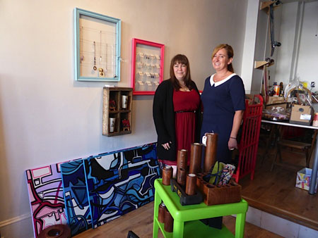 Casey Lynch and Tami Horvath, owners of Street Glitter Gallery with Victor Perez. In addition to a storefront renovation, the owners received visual merchandising assistance through the CORE program and recently opened their doors to the public. Street Glitter is now a retail space for local artists.